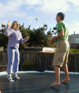 Playing ball on the trampoline